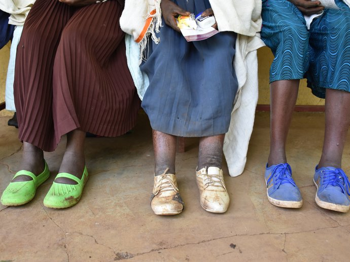 Women with podoconiosis wait outside a clinic in Ethiopia
