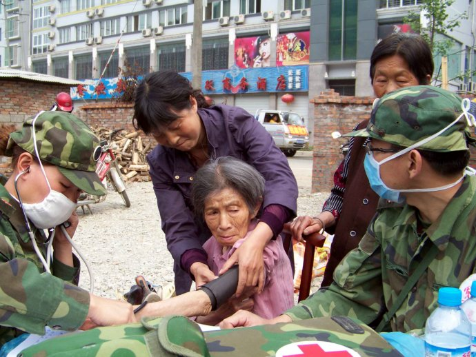 Women getting blood pressure checked by Chinese army