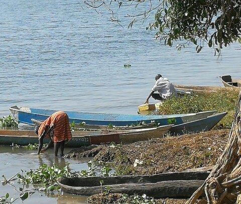 Water collection along the Nile River, Kamuli District, Uganda